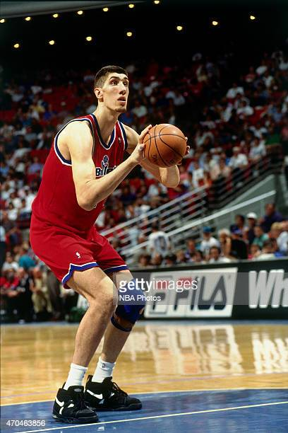 Gheorghe Muresan of the Washington Bullets attempts a free throw against the Orlando Magic on April 17 1995 at the Amway Arena in Orlando Florida...