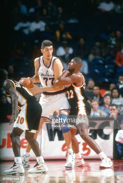 Gheorghe Muresan of the Washington Bullets backs in on Reggie Jordan of the Atlanta Hawks during an NBA basketball game circa 1995 at the US Airways...
