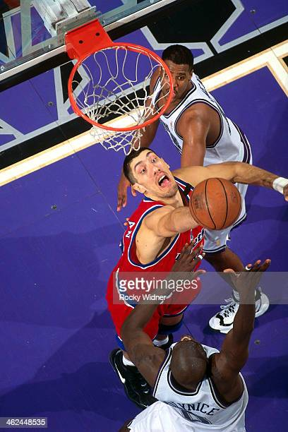 Gheorghe Muresan of the Washington Bullets blocks a shot attempt against the Sacramento Kings during a game played on December 16 1996 at Arco Arena...