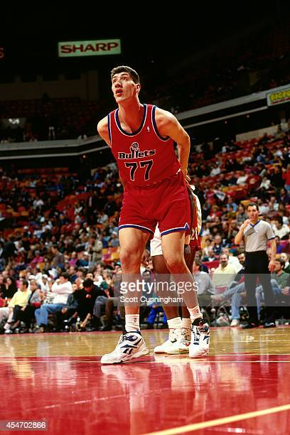 Gheorghe Muresan of the Washington Bullets boxes out against the Atlanta Hawks circa 1994 at the OMNI in Atlanta, Georgia. NOTE TO USER: User...