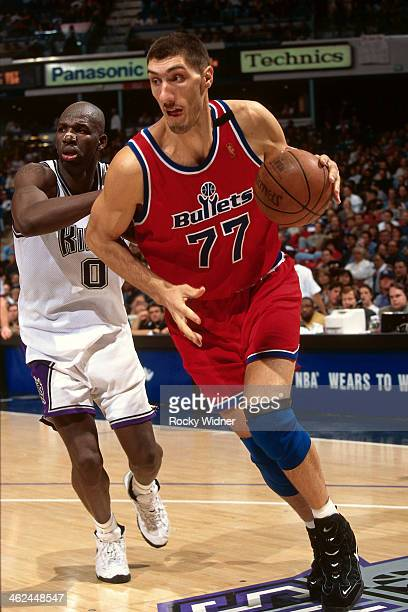 Gheorghe Muresan of the Washington Bullets dribbles the ball against the Sacramento Kings during a game played on December 16 1996 at Arco Arena in...