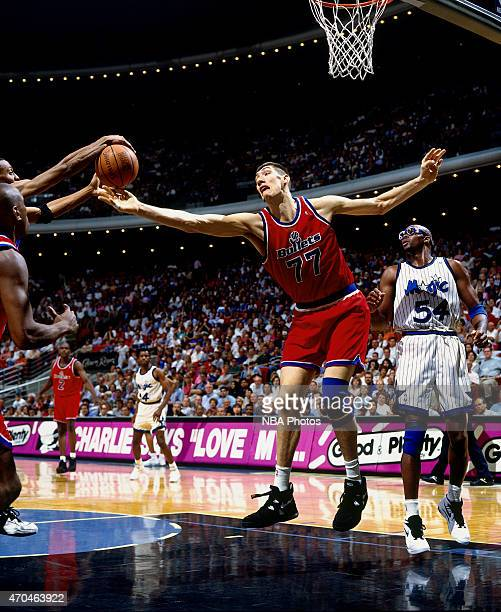 Gheorghe Muresan of the Washington Bullets grabs a rebound against the Orlando Magic on April 17 1995 at the Amway Arena in Orlando Florida NOTE TO...