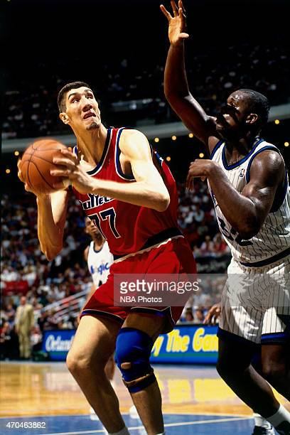 Gheorghe Muresan of the Washington Bullets handles the ball against the Orlando Magic on April 17 1995 at the Amway Arena in Orlando Florida NOTE TO...