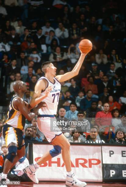 Gheorghe Muresan of the Washington Bullets in action against the Indiana Pacers during an NBA basketball game circa 1995 at the US Airways Arena in...