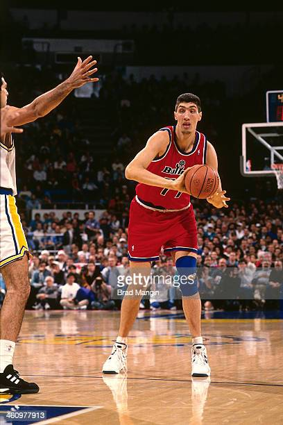 Gheorghe Muresan of the Washington Bullets passes against the Golden State Warriors during a game played circa 1995 at the Oakland Coliseum in...