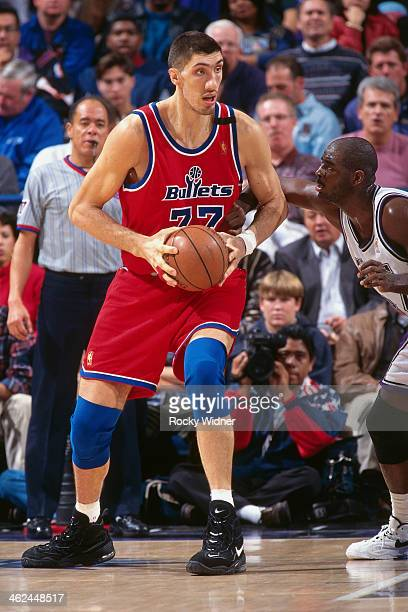 Gheorghe Muresan of the Washington Bullets posts up against the Sacramento Kings during a game played on December 16 1996 at Arco Arena in Sacramento...