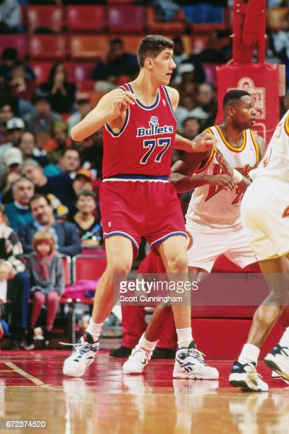 Gheorghe Muresan of the Washington Bullets posts up against the Atlanta Hawks during a game played circa 1990 at the Omni in Atlanta Georgia NOTE TO...