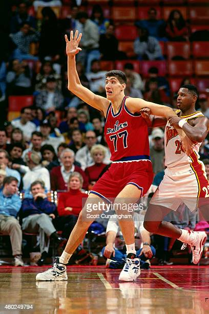 Gheorghe Muresan of the Washington Bullets posts up against the Atlanta Hawks circa 1994 at the Omni in Atlanta Georgia NOTE TO USER User expressly...