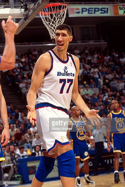 Gheorghe Muresan of the Washington Bullets reacts against the Golden State Warriors during a game played on December 15 1996 at the San Jose Arena in...