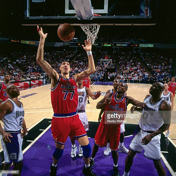 Gheorghe Muresan of the Washington Bullets rebounds against the Sacramento Kings during a game played on December 16, 1996 at Arco Arena in...