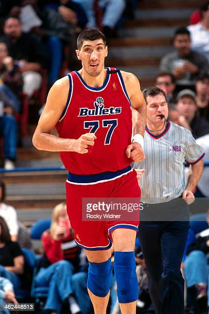 Gheorghe Muresan of the Washington Bullets runs against the Sacramento Kings during a game played on December 16 1996 at Arco Arena in Sacramento...