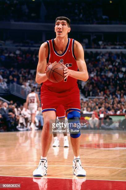 Gheorghe Muresan of the Washington Bullets shoots a foul shot during a game played on November 5 1994 at the United Center in Chicago Illinois NOTE...