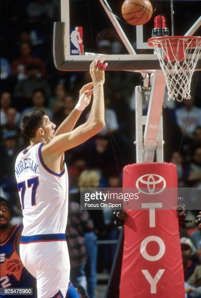 Gheorghe Muresan of the Washington Bullets shoots against the Phoenix Suns during an NBA basketball game circa 1995 at the US Airways Arena in...