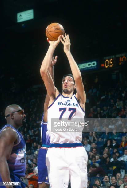 Gheorghe Muresan of the Washington Bullets shoots against the Utah Jazz during an NBA basketball game circa 1995 at the US Airways Arena in Landover,...