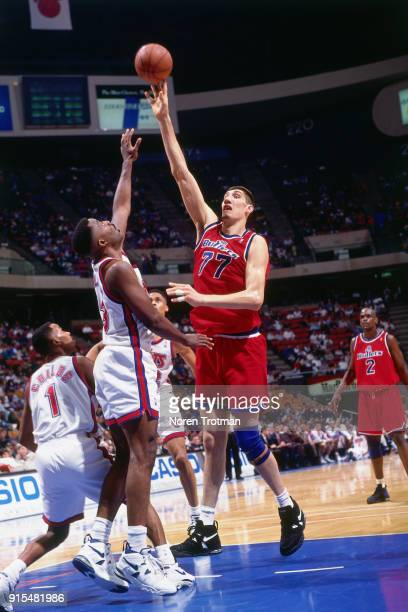 Gheorghe Muresan of the Washington Bullets shoots during a game played on April 21 1995 at Continetal Airlines Arena in East Rutherford New Jersey...