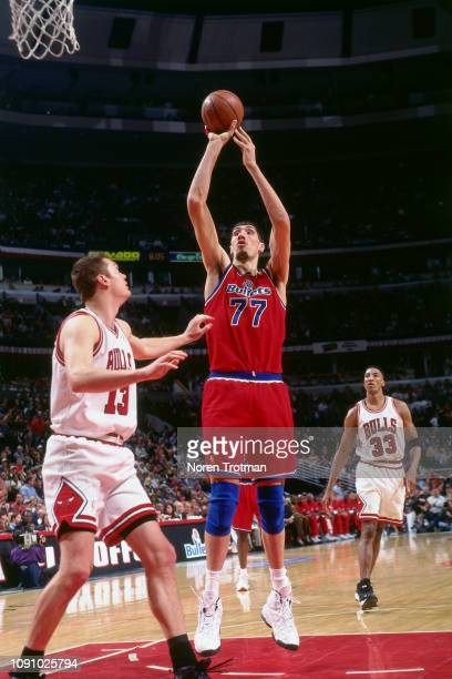 Gheorghe Muresan of the Washington Bullets shoots the ball against the Chicago Bulls on April 27 1997 during Game One of the NBA Eastern Conference...