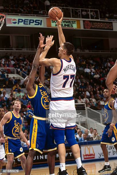 Gheorghe Muresan of the Washington Bullets shoots the ball against the Golden State Warriors during a game played on December 15 1996 at the San Jose...