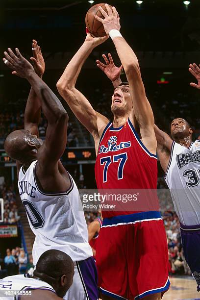 Gheorghe Muresan of the Washington Bullets shoots the ball against the Sacramento Kings during a game played on December 16 1996 at Arco Arena in...