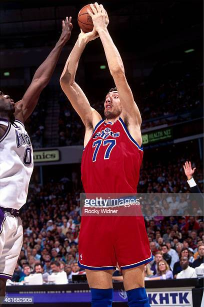 Gheorghe Muresan of the Washington Bullets shoots the ball during a game played on March 3, 1996 at Arco Arena in Sacramento, California. NOTE TO...