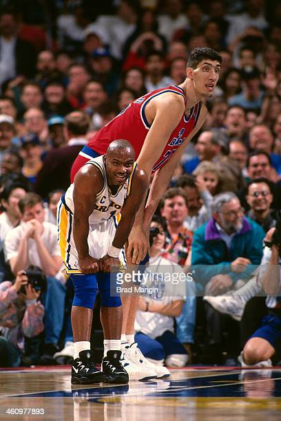 Gheorghe Muresan of the Washington Bullets stands against Tim Hardaway of the Golden State Warriors during a game played circa 1995 at the Oakland...
