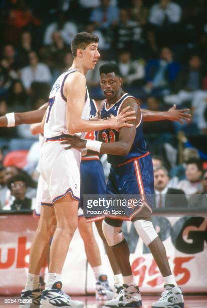 Gheorghe Muresan of the Washington Bullets works for position on Patrick Ewing of the New York Knicks during an NBA basketball game circa 1994 at the...