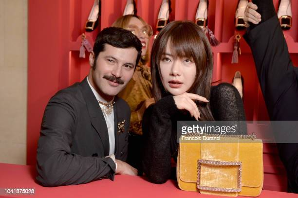 Gherardo Felloni and Qi Wei attend the Roger Vivier Presentation Spring/Summer 2019 during Paris Fashion Week on September 27 2018 in Paris France
