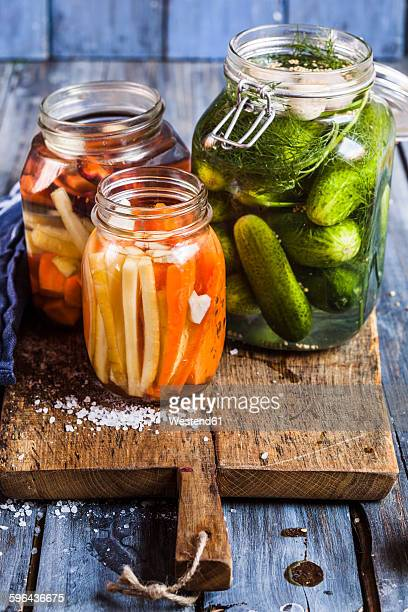 Gherkins fermenting, gherkins and carrots in preserving jars