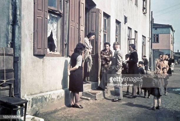 Ghetto Lodz, Litzmannstadt, Hans Biebow, chief ofÊGerman Nazi administration of the Lodz Ghetto is talking with residents, Poland 1940, World War II.