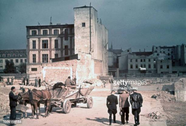 Ghetto Lodz, Litzmannstadt, Hans Biebow, chief ofÊthe German Nazi administration of theÊLodz ghetto surveys a street in the ghetto with other...