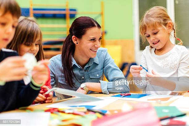ghildren having creative activity in kindergarten. - primary age child stock pictures, royalty-free photos & images