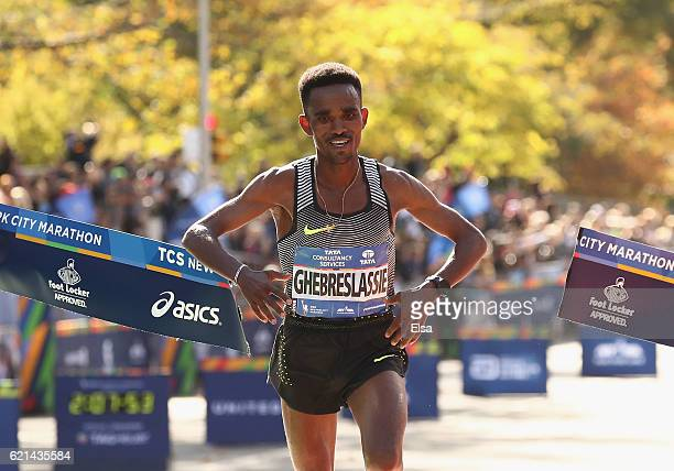 Ghirmay Ghebreslassie of Eritrea celebrates as he crosses the finish line to finish first in the Professional Men's Division during the 2016 TCS New...