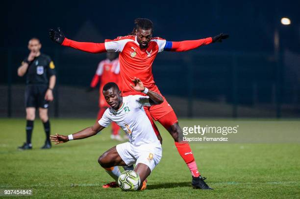 Ghislain Konan of Ivory Coast and Emmanuel Adebayor of Togo during the International friendly match between Togo and Ivory Coast on March 24 2018 in...