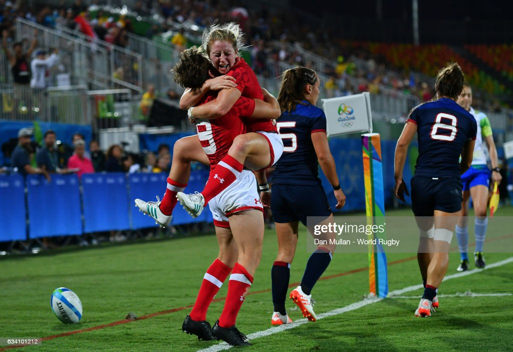 Ghislaine Landry of Canada (L) celebrates after scoring a try with Kayla Moleschi of Canada during the Women's Rugby Sevens Quarter Final match between Canada and France on Day 2 of the 2016 Rio Olympic Games at Deodoro Stadium on August 7, 2016 in Rio de Janeiro, Brazil.
