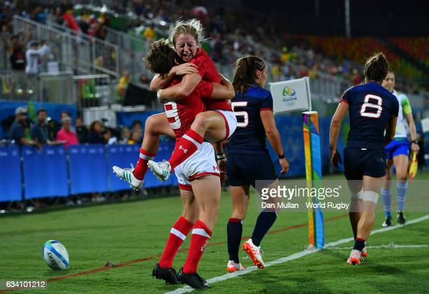 Ghislaine Landry of Canada celebrates after scoring a try with Kayla Moleschi of Canada during the Women's Rugby Sevens Quarter Final match between...