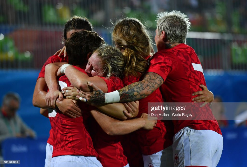 Ghislaine Landry of Canada (L) celebrates with her team mates after scoring a try during the Women's Rugby Sevens Quarter Final match between Canada and France on Day 2 of the 2016 Rio Olympic Games at Deodoro Stadium on August 7, 2016 in Rio de Janeiro, Brazil.