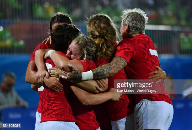Ghislaine Landry of Canada celebrates with her team mates after scoring a try during the Women's Rugby Sevens Quarter Final match between Canada and...