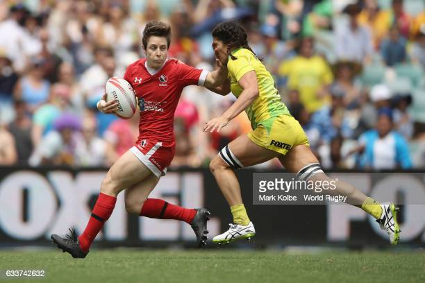 Ghislaine Landry of Canada tries to fend off Charlotte Caslick of Australia during the womens cup semi final match between Australia and Canada in...