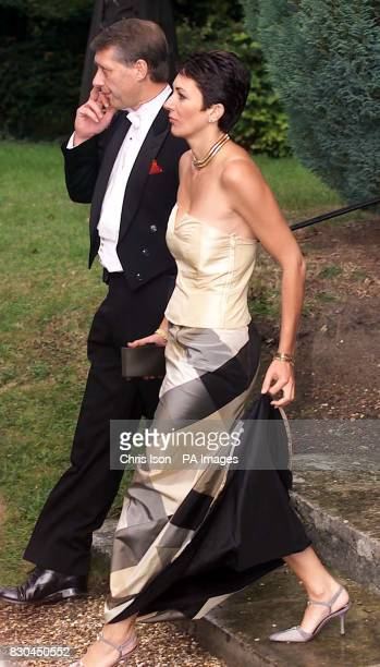 Ghislaine Maxwell arrives with one of the Duke of York's detectives to the wedding of a former girlfriend Aurelia Cecil at the Parish Church of St...