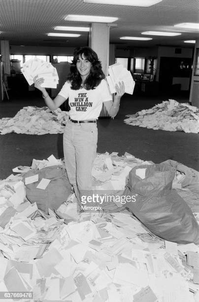 Ghislaine Maxwell daughter of Mirror Group publisher Mr Robert Maxwell sifting through the mountain's of 'Draw Coupon' entries at Maxwell House 2nd...