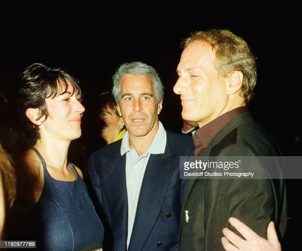 Ghislaine Maxwell Jeffrey Epstein and musician Michael Bolton pose for a portrait during a party at the MaraLago club Palm Beach Florida February 12...