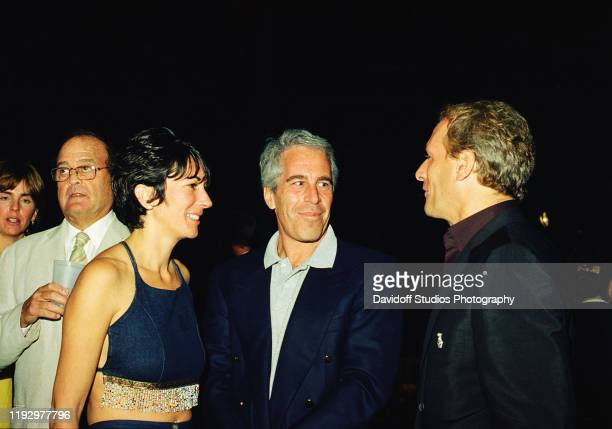 Ghislaine Maxwell, Jeffrey Epstein, and musician Michael Bolton pose for a portrait during a party at the Mar-a-Lago club, Palm Beach, Florida,...