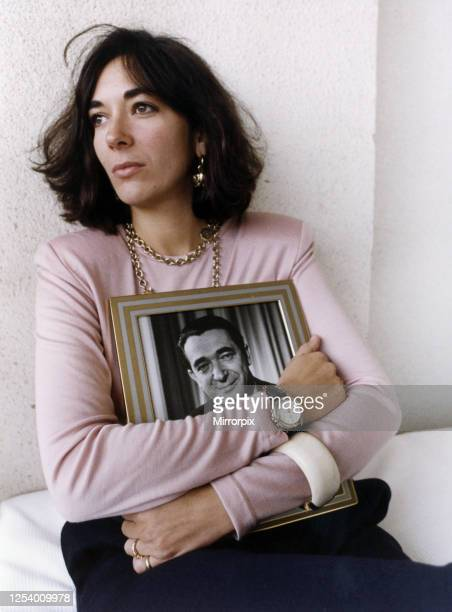 Ghislaine Maxwell, youngest child of media proprietor and fraudster, Robert Maxwell , holding a framed photograph of her late father, Jerusalem,...