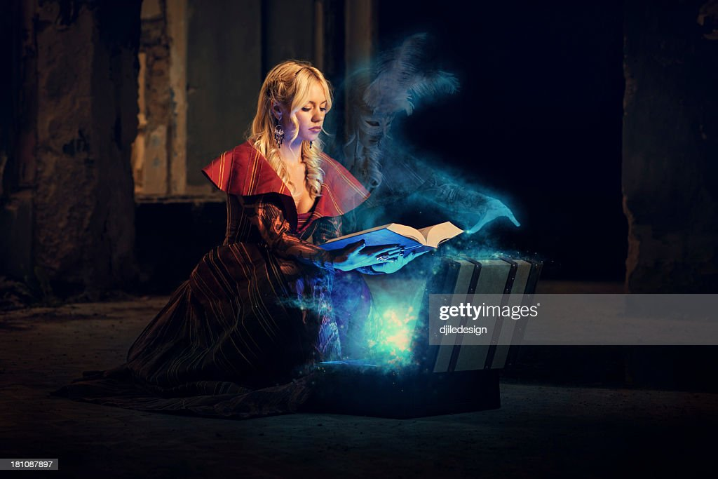 Ghost and mysterious book of magic : Stock Photo