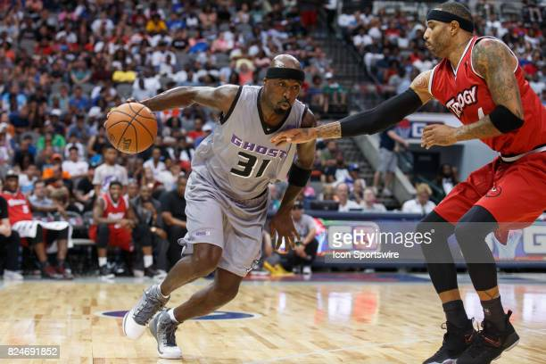 Ghost Ballers guard Ricky Davis drives as Trilogy forward Kenyon Martin defends during the Big3 basketball game between the Ghost Ballers and Trilogy...