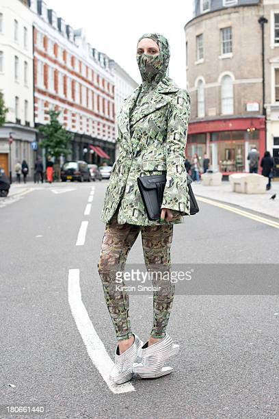 Ghost blogger Carmen Debeavoir wears Nude Republic shoes, Asos bag, leggings, top and jacket by Dans La Vie on day 3 of London Fashion Week...
