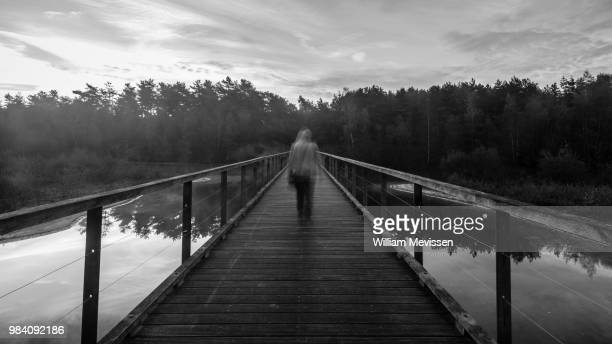 ghost bridge - william mevissen stock pictures, royalty-free photos & images