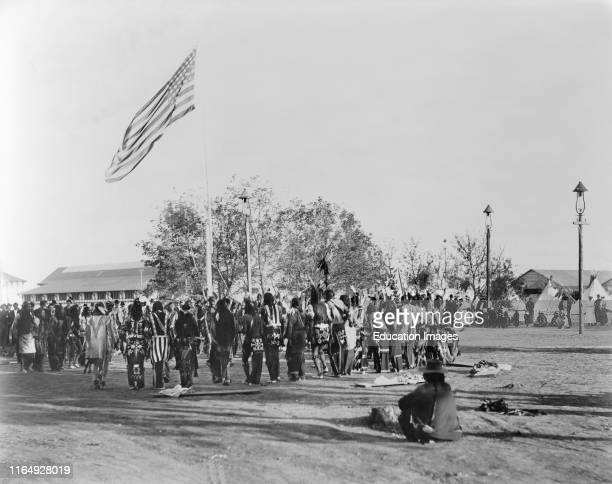 Ghost Dance, Cheyennes & Arapahoes in Circle around Flagpole, Indian Congress of the Trans-Mississippi and International Exposition, by Adolph F...