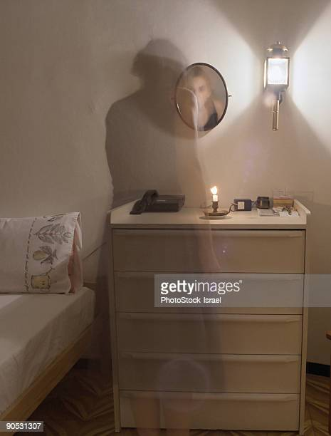 Ghost figure in bedroom,