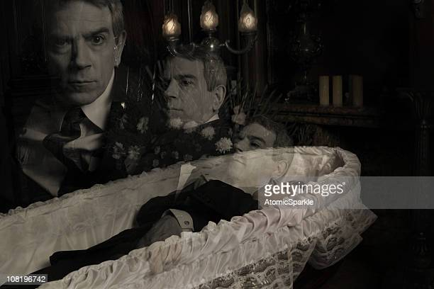 ghost of dead man in casket rising - coffin stock pictures, royalty-free photos & images