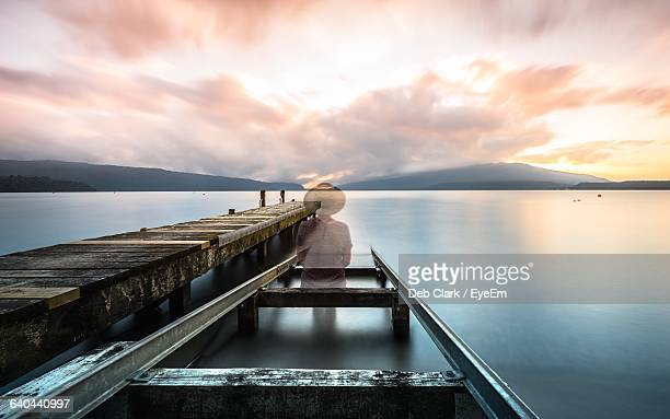 ghost on damaged pier in lake during sunset - hamilton new zealand stock pictures, royalty-free photos & images
